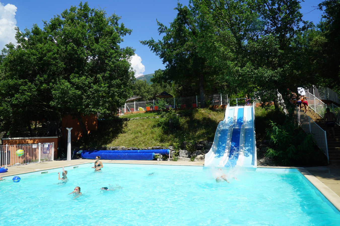 Campsite's swimming pool with water slide